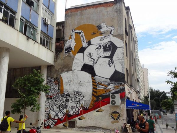 Street-Art-FIFA-World-Cup-in-Rio-de-Janeiro-Brazil-From-Anti-Copa-Mural-Project-organized-by-Colorrevolution-e.V.-and-Amnesty-International-Brazil.-By-B.ShantiA.Signl-in-Rio-de-Jainero-B